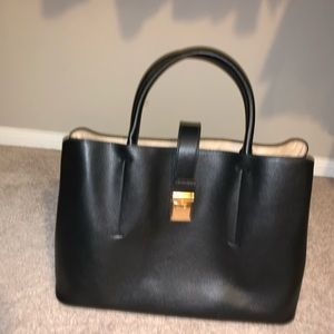 Black satchel with strap